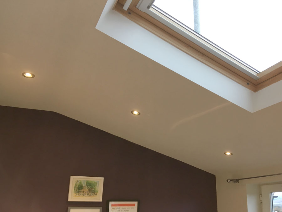 Downlights in pitched roof.
